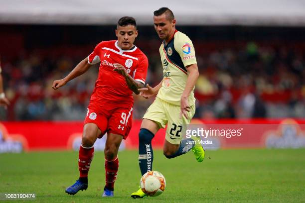 Alexis Vega of Toluca fights for the ball with Paul Aguilar of America during a 15th round match between Club America and Toluca as part of Torneo...