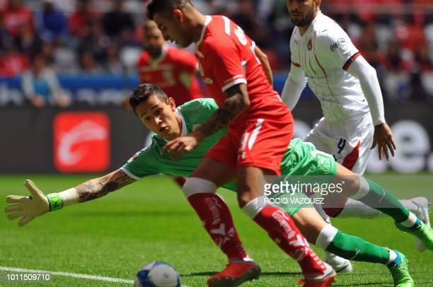 Alexis Vega of Toluca struggles to score past Guadalajara's goalie Raul Gudino during the Mexican Apertura 2018 tournament football match at the...
