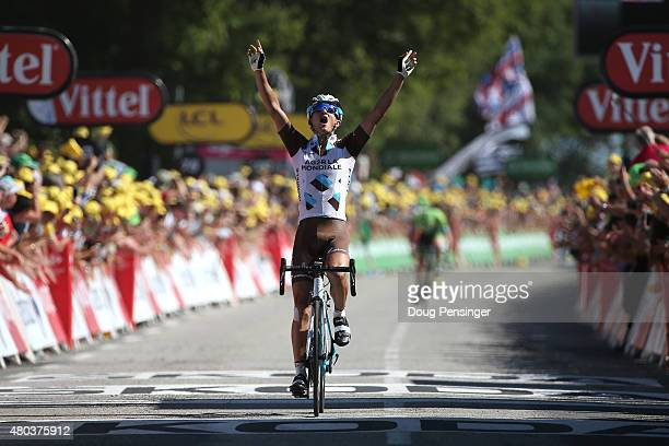Alexis Vuillermoz of France and AG2R La Mondial Team celebrates victory as he crosses the finish line to win stage eight of the 2015 Tour de France a...