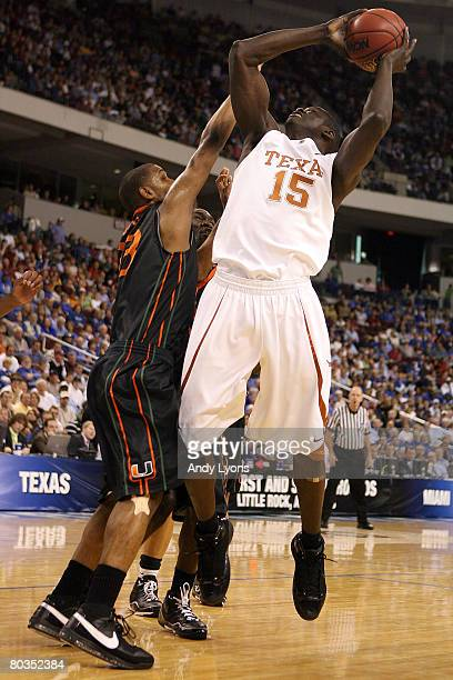 Alexis Wangmene of the Texas Longhorns goes up to shoot over James Dews of the Miami Hurricanes during the second round of the South Regional as part...