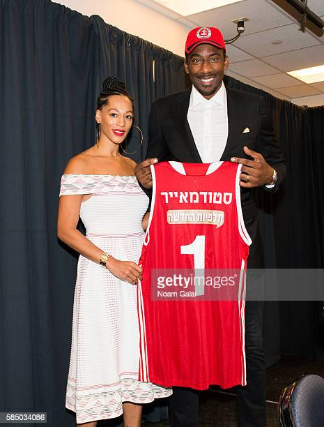 Alexis Welch and Amar'e Stoudemire pose at a press conference to announce Amar'e Stoudemire's retirement from the NBA and for signing a contract with...