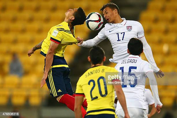 Alexis Zapata of Colombia is challenged by Desevio Payne of USA during the FIFA U20 World Cup New Zealand 2015 Round of 16 match between USA and...