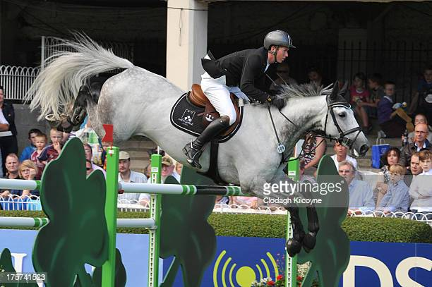 Alexoner Butler on Will Wimble and of Ireland take part in the RDS Dublin Horse Show 'Irish Sports Council Classic' International Competition in the...