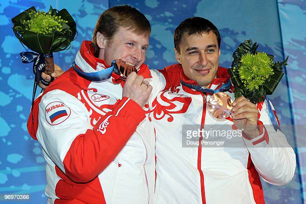 Alexsandr Zubkov and Alexey Voevoda of Russia receive the bronze medal during the medal ceremony for the men's twoman bobsleigh on day 11 of the...
