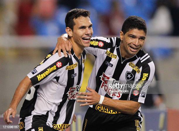 Alexssander and Renato of Botafogo celebrate a scored goal againist America MG during a match as part of Serie A 2011 at Engenhao stadium on August...