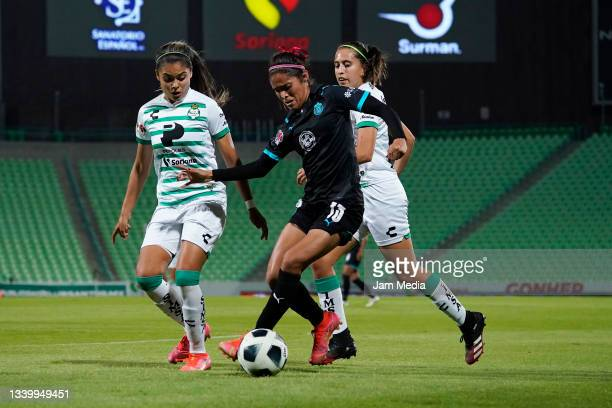 Alexxandra Ramirez and Karyme Martinez of Santos fight for the ball with Joseline Montoya of Chivas during a match between Santos and Chivas as part...