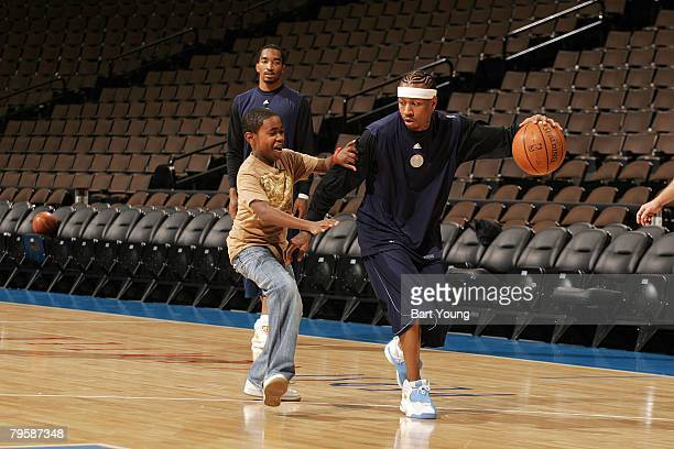 Alezander McIntosh from the MakeAWish Foundation spends the morning with Allen Iverson of the Denver Nuggets at the Pepsi Center on February 6 2008...
