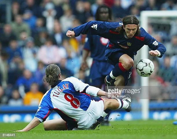 Alezei Smertin of Portsmouth leaps over Tugay of Blacburn Rovers during the FA Barclaycard Premiership match between Blackburn Rovers and Portsmouth...