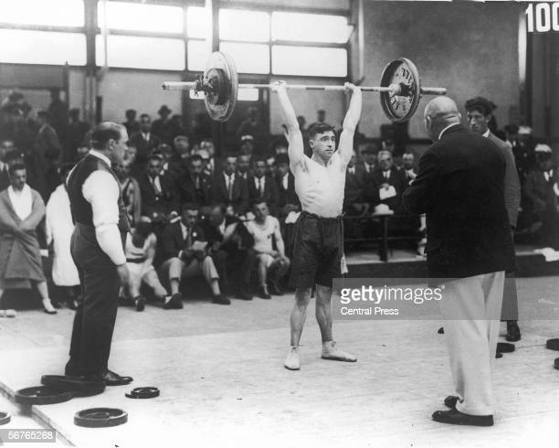Alf Baxter of Great Britain competes in a weightlifting event at the Amsterdam Olympics, 30th July 1928.