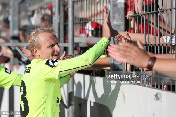 Alf Mintzel of SV Wehen Wiesbaden celebrates with fans after the 3 Liga match between Karlsruher SC and SV Wehen Wiesbaden at Wildparkstadion on...