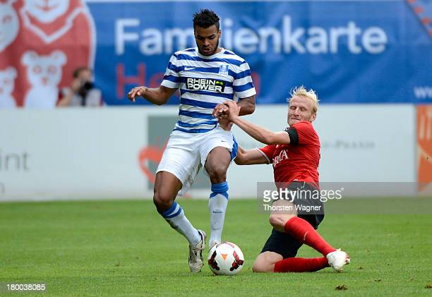 Alf Mintzel of Wiesbaden battles for the ball with Phil OfosuAyeh of Duisburg during the Third Bundesliga match between SV Wehen Wiesbaden and MSV...