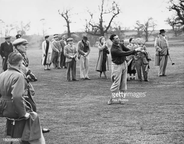 Alf Padgham watches his approach shot to the 11th green off the fairway during an exhibition match against Percy Alliss on 20th May 1933 at the West...