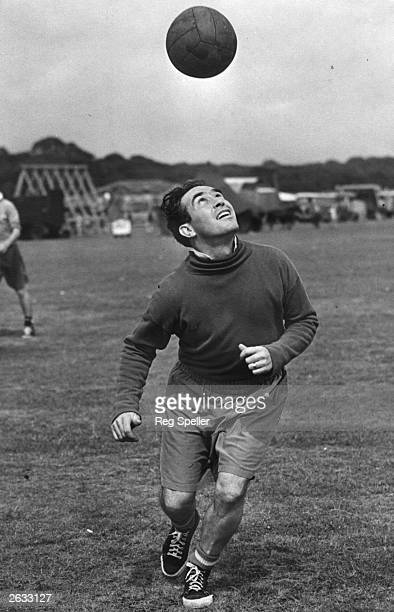Alf Ramsey captain of Tottenham Hotspur Football Club in action during a training session at Epping Forest for the forthcoming soccer season Original...