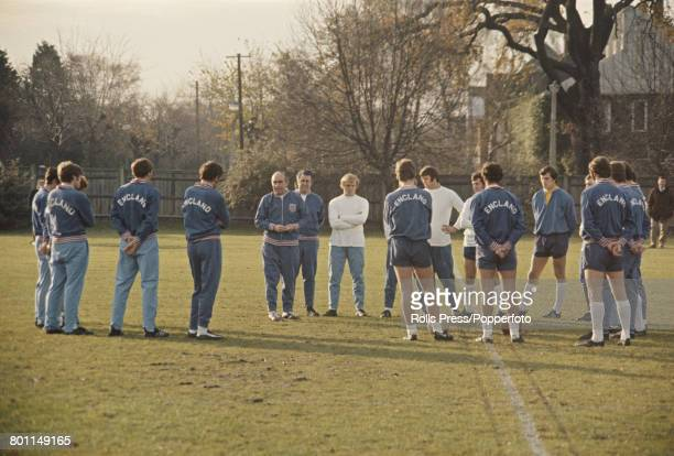 Alf Ramsey manager of the England national football team pictured in centre with assistant trainer Harold Shepherdson and squad members during a...