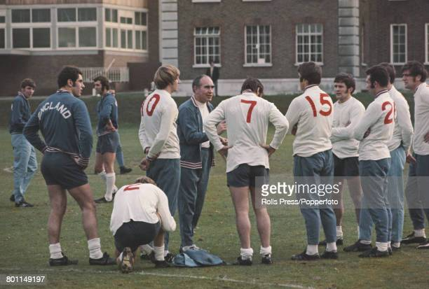 Alf Ramsey manager of the England national football team pictured in centre with squad members during a training session at Roehampton London on 24th...