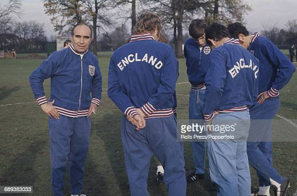 Alf Ramsey manager of the England national football team pictured with members of the England football squad including Bobby Moore and Martin Peters...