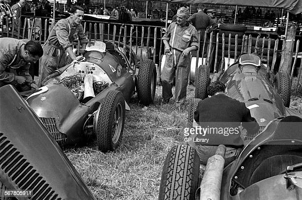 Alfa Romeo 158s being preprared by the team mechanics in the paddock at Silverstone England 1951