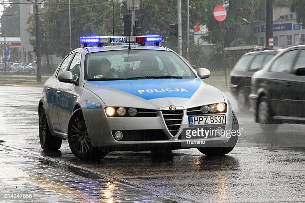 alfa romeo 159 police car on the street - polish culture stock pictures, royalty-free photos & images