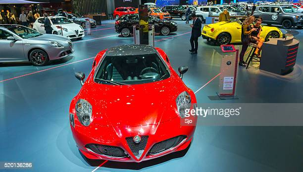 alfa romeo 4c coupe sports car at the show stand - alfa romeo stock pictures, royalty-free photos & images