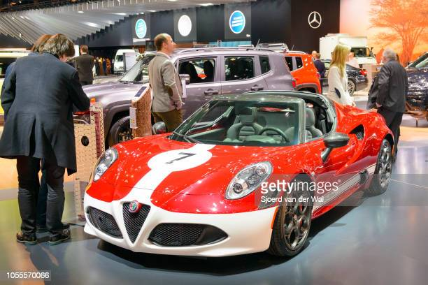 Alfa Romeo 4C Spider compact lightweight sports car in red with white decals on display at Brussels Expo on January 13 2017 in Brussels Belgium The...