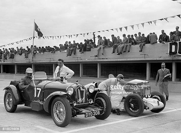 Alfa Romeo and supercharged MG Midget on the start line at Brooklands 1938 or 1939 Left Alfa Romeo Vehicle Reg No DYO308 Event Entry No 17 Right MG...