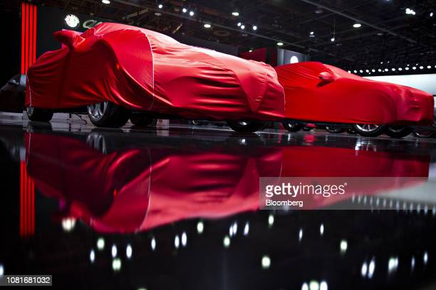 Alfa Romeo Automobiles SpA vehicles sit under red covers ahead of the 2019 North American International Auto Show in Detroit, Michigan, U.S., on...
