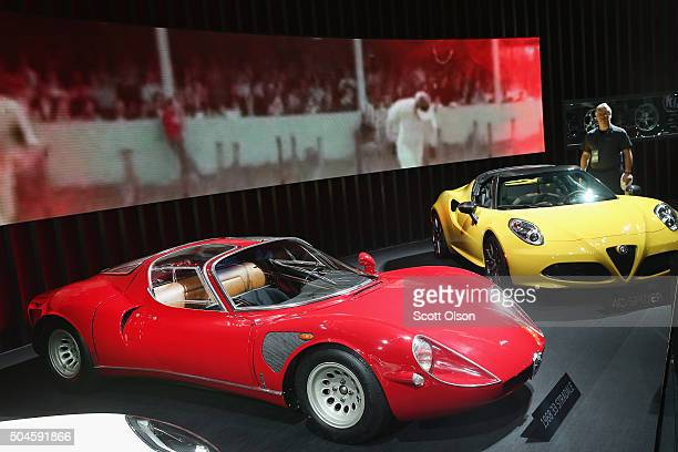 Alfa Romeo displays a 1968 33 Stradale next to a C4 at the North American International Auto Show on January 11 2016 in Detroit Michigan The show is...