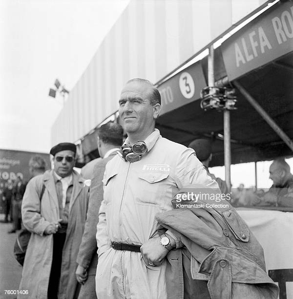 Alfa Romeo driver Nino Farina standing in front of the Silverstone pits during practice at the British Grand Prix, Silverstone, 13th May 1950....