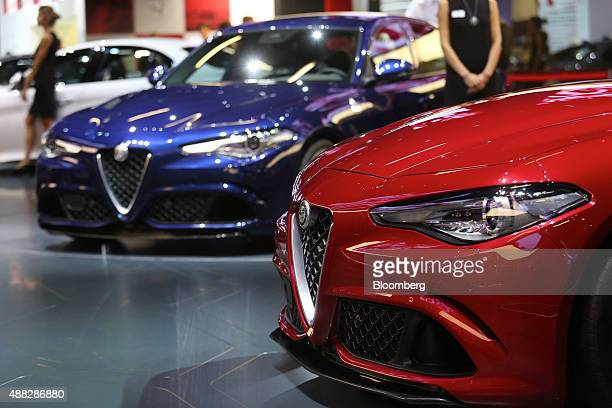 Alfa Romeo Giulia automobiles produced by Fiat SpA sit on display during previews at the IAA Frankfurt Motor Show in Frankfurt Germany on Tuesday...