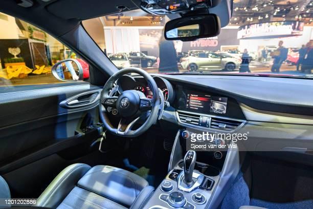 Alfa Romeo GIulia sedan interior on display at Brussels Expo on January 9, 2020 in Brussels, Belgium. The Alfa Romeo Giulia uses a front-engine,...
