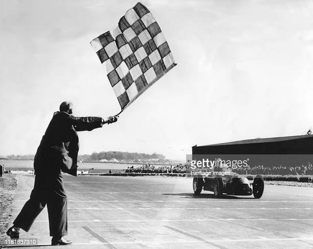 Alfa Romeo, Giuseppe Farina takes chequered flag, British Grand Prix at Silverstone 1950. Creator: Unknown.