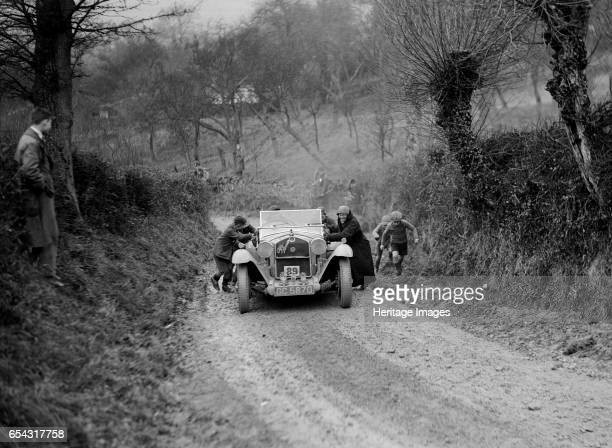 Alfa Romeo of KD Evans getting a push at the NWLMC LondonGloucester Trial 1931 Artist Bill Brunell Alfa Romeo 1930 1500 cc Vehicle Reg No GC5870...