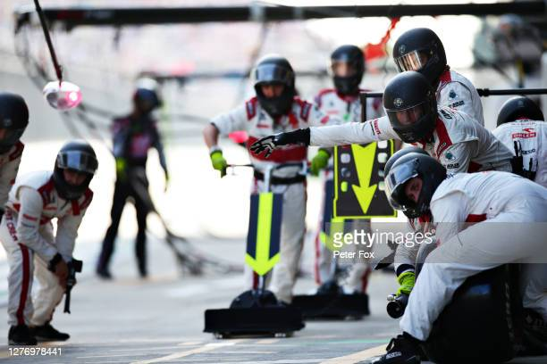 Alfa Romeo Racing team members prepare for a pit stop during the F1 Grand Prix of Russia at Sochi Autodrom on September 27 2020 in Sochi Russia