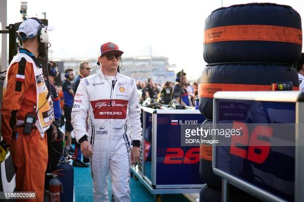 Alfa Romeo Racing's Finnish driver Kimi Raikkonen walks on the grid before the Abu Dhabi F1 Grand Prix race at the Yas Marina Circuit in Abu Dhabi