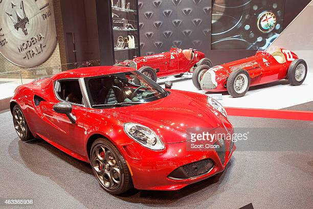 Alfa Romeo shows of the 4C Launch edition alongside some of their classic race cars at the Chicago Auto Show during the media preview on February 13...