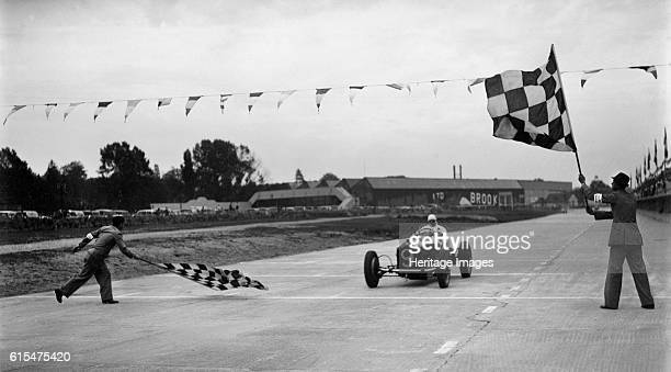 Alfa Romeo taking the chequred flag in a race at Brooklands Alfa Romeo 2669S cc Event Entry No 9 Place Brooklands Artist Bill Brunell