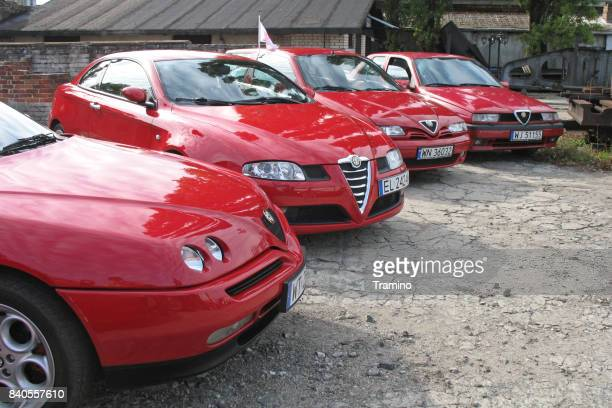 alfa romeo vehicles on the meeting of italian car friends - alfa romeo stock pictures, royalty-free photos & images