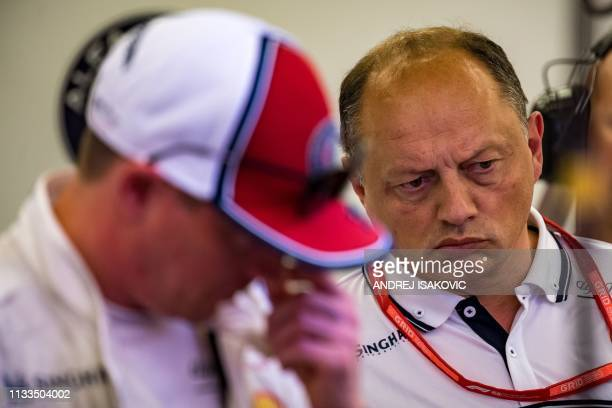 Alfa Romeo's Finnish driver Kimi Raikkonen and Alfa Romeo team principal Fred Vasseur look at the car during the second practice session ahead of the...