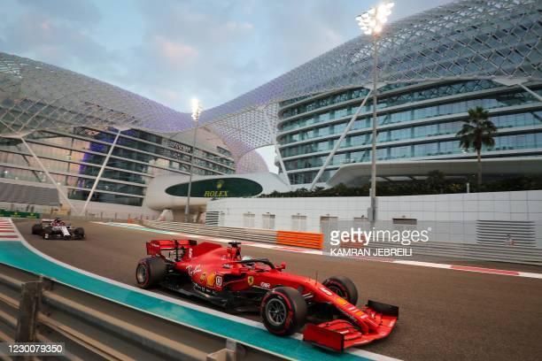 Alfa Romeo's Finnish driver Kimi Raikkonen competes behind Ferrari's German driver Sebastian Vettel during the qualifying session on the eve of the...