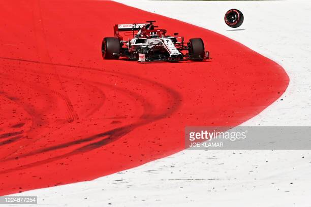 Alfa Romeo's Finnish driver Kimi Raikkonen looses his front wheel during the Austrian Formula One Grand Prix race on July 5, 2020 in Spielberg,...