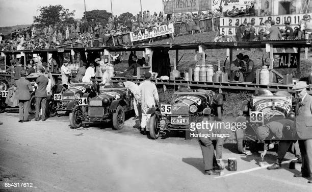 Alfa Romeos in the pits at the RAC TT Race Ards Circuit Belfast 1929 Artist Bill Brunell Alfa Romeo 1487S ccEntry No 32 Driver Ivanowsky B Left of...