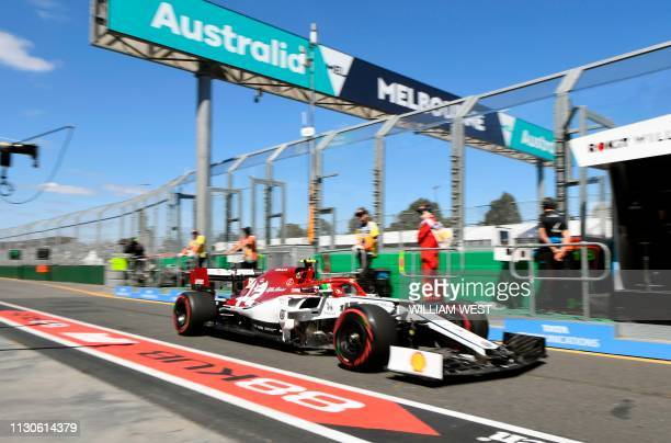 Alfa Romeo's Italian driver Antonio Giovinazzi speeds out of pit lane during the first Formula One practice session in Melbourne on March 15 ahead of...