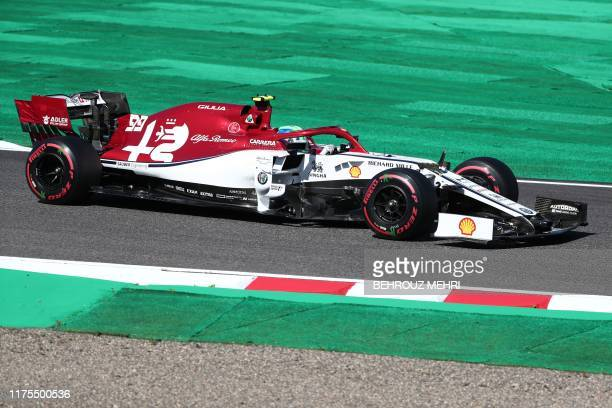 Alfa Romeo's Italian driver Antonio Giovinazzi takes part in the qualifying session for the Formula One Japanese Grand Prix at Suzuka on October 13...