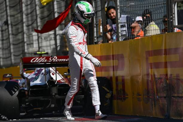 Alfa Romeo's Italian driver Antonio Giovinazzi walks away from his car after a crash during the qualifying session for the Formula One Azerbaijan...