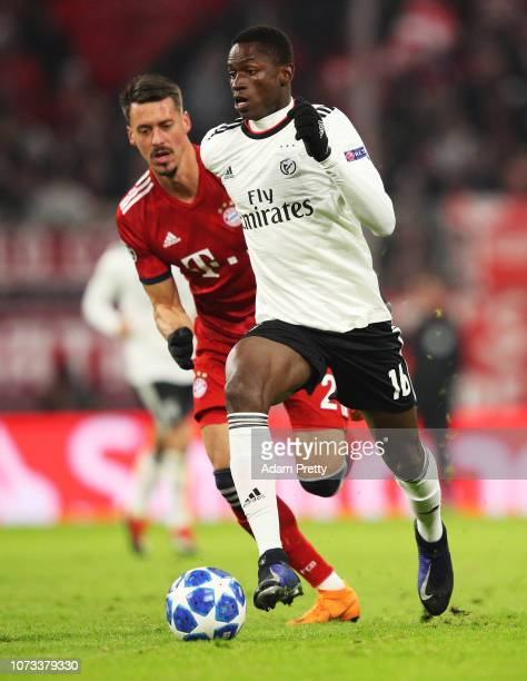 Alfa Semedo is challenged by Sandro Wagner of Bayern Munich during the Group E match of the UEFA Champions League between FC Bayern Muenchen and SL...