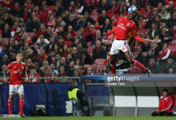 Alfa Semedo of SL Benfica and Ezequiel Ponce of AEK Athens jump to head the ball during the UEFA Champions League Group E match between SL Benfica...