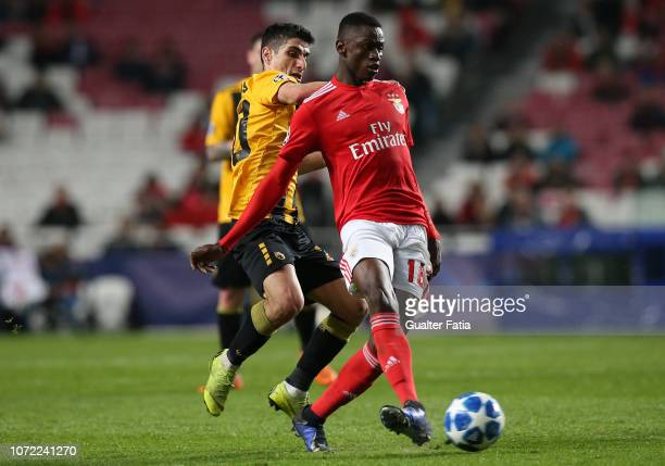 Alfa Semedo of SL Benfica competes for the ball with Petros Mantalos of AEK Athens during the UEFA Champions League Group E match between SL Benfica...