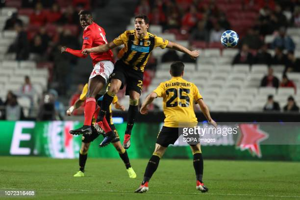 Alfa Semedo of SL Benfica vies for the ball with Ezequiel Ponce of AEK Athens FC during the UEFA Champions League 2018/19 football match between SL...