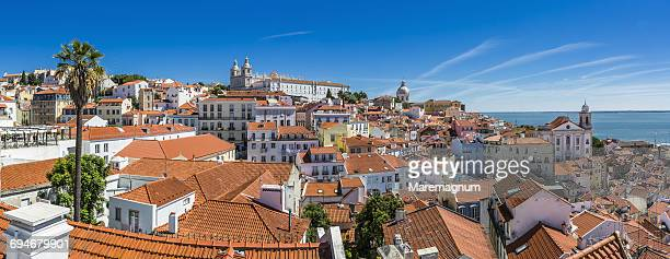 alfama district and the rio (river) tejo - alfama stock photos and pictures