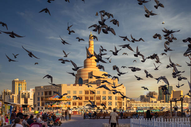 Al-Fanar Qatar Islamic Cultural Center Daylight Exterior View With Pigeons Flying In The Sky